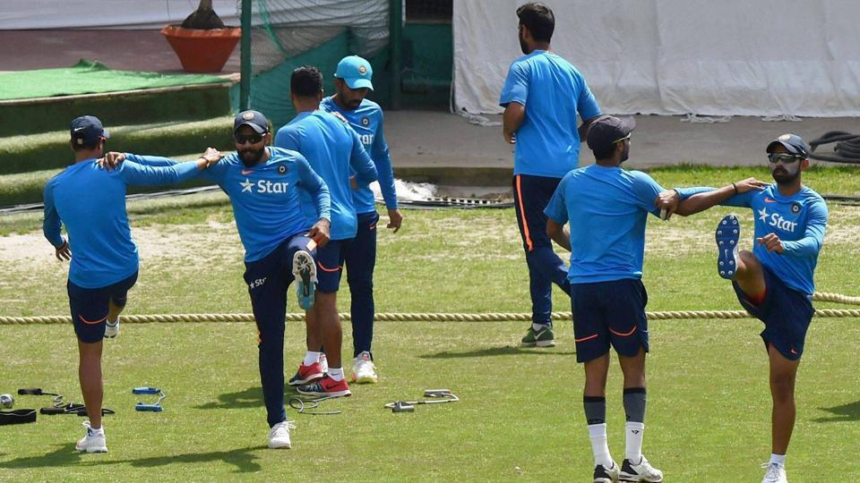 Indian cricket players warm up during a practice session ahead of the last test match against Australia at HPCA Stadium. (PTI)