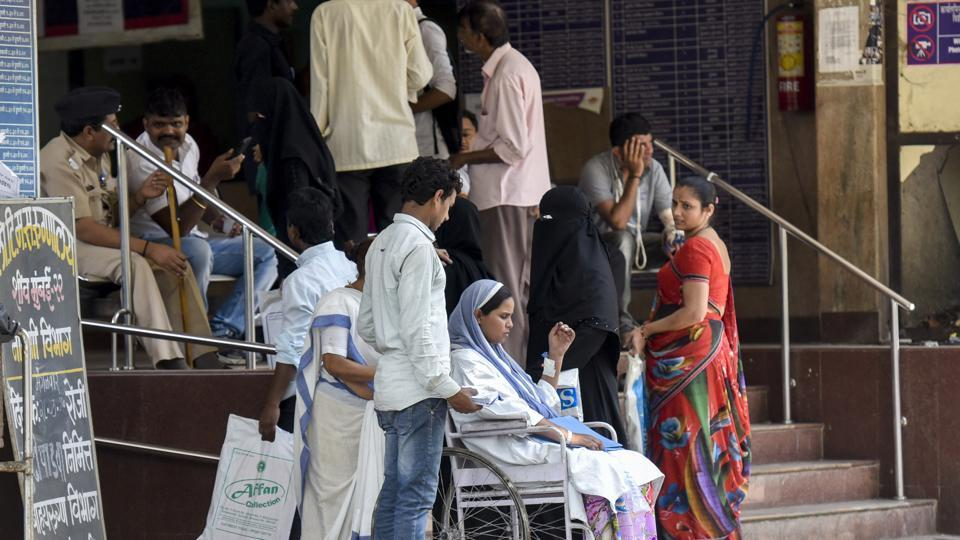 Patients and their relatives neat the OPDat Sion Hospital in Mumbai on Wednesday.