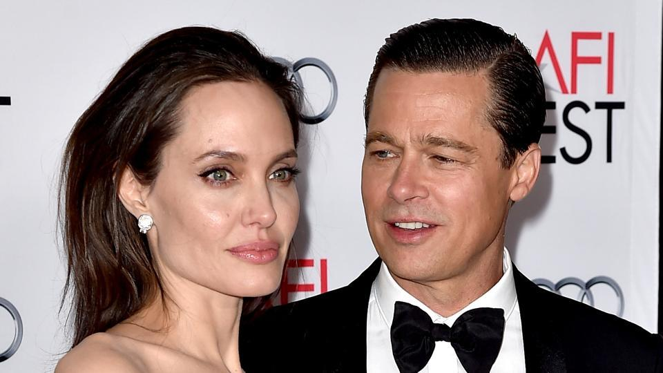 This file photo taken on November 4, 2015 shows actor/director Angelina Jolie Pitt (L) and her estranged husband actor Brad Pitt as they arrive at the AFI FEST 2015.