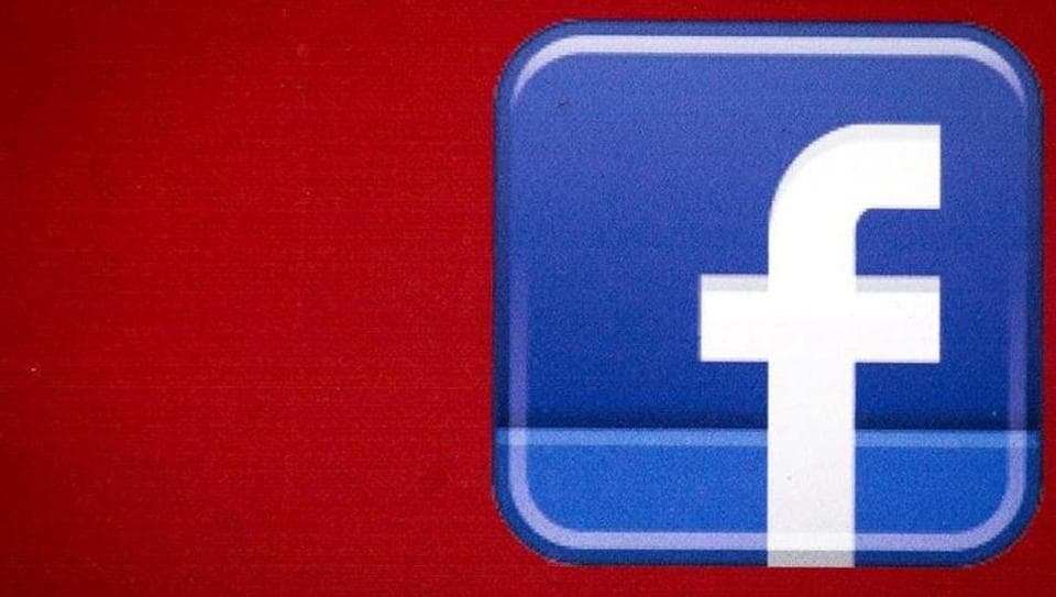 A Facebook logo is displayed on the side of a tour bus in New York's financial district.