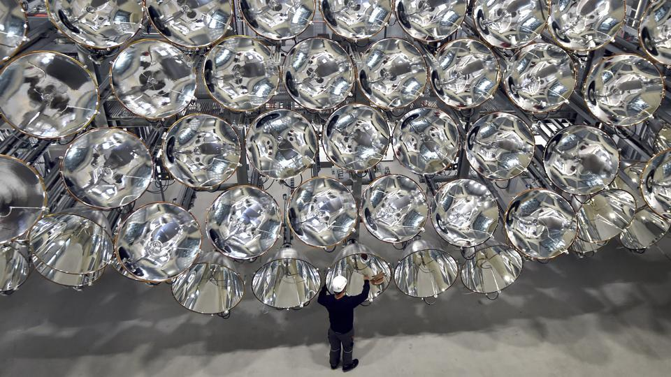 Engineer Volkmar Dohmen stands in front of xenon short-arc lamps in the DLR German national aeronautics and space research centre in Juelich, western Germany. The lights are part of an artificial sun that will be used for research purposes.