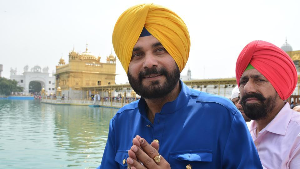 Punjab local bodies minister Navjot Singh Sidhu paying at Golden Temple in  Amritsar on Wednesday.
