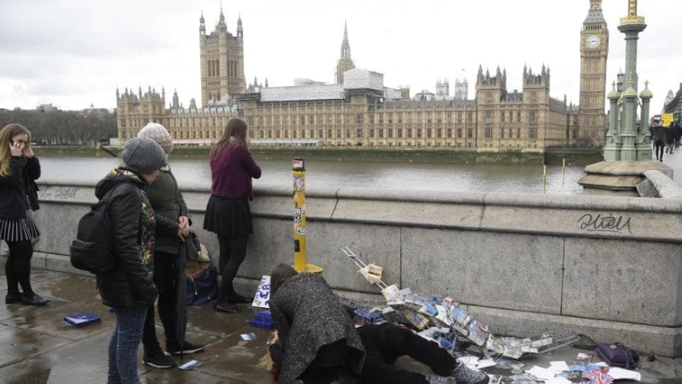 An injured woman is assisted after an incident on Westminster Bridge in London, Britain.
