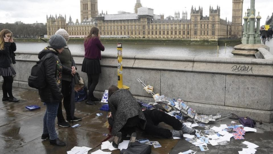 An injured woman is assisted after an incident on Westminster Bridge in London.