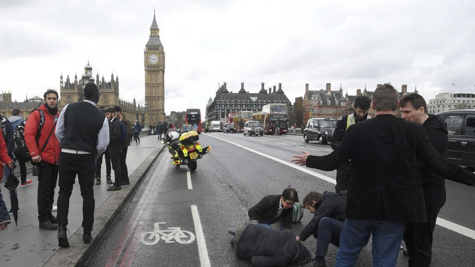 An injured person is assisted after the incident on Westminster Bridge in London, March 22.  The shock of this attack was less about the casualties – luckily far fewer than earlier jihadi actions in Paris, Brussels and Nice – than the symbolic value of the target: Britain's Parliament building at a time when both its prime minister and its parliamentarians were in session.