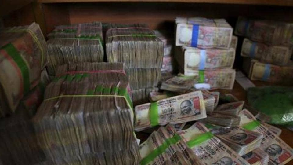 Discontinued Indian currency notes of 1,000 denomination are seen after they were deposited by people at a bank in Bangalore, India.