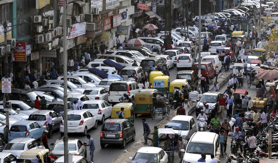 Cars parked on the main road in Karol Bagh's Ghaffar Market.