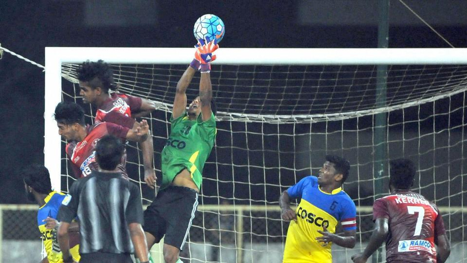 Kerala and Goa players vie for the ball during their Santosh Trophy semifinal match in Mambolim on Thursday. Goa beat Kerala and will take on Bengal, who beat Mizoram in the other semifinal.