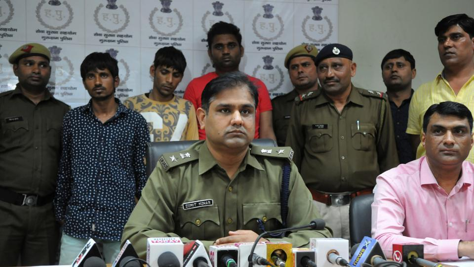 Police personnel with the three men arrested for abducting and killing Haryanvi singer Lala Saini.