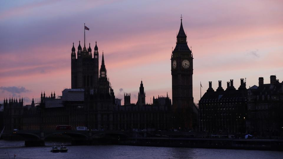 The sun sets behind the Houses of Parliament after an attack on Westminster Bridge in London.