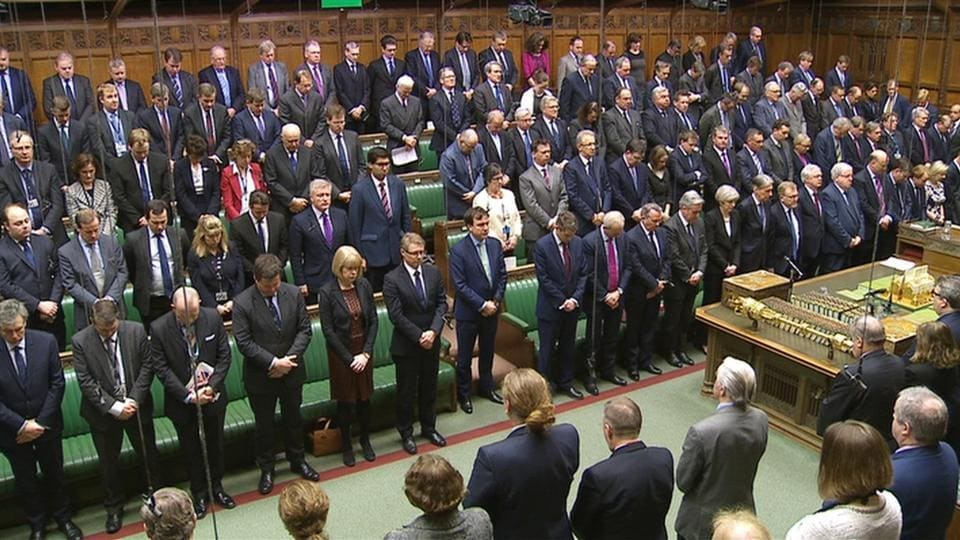 Members of parliament stand for a minute's silence the morning after an attack in Westminster, London, on Thursday.