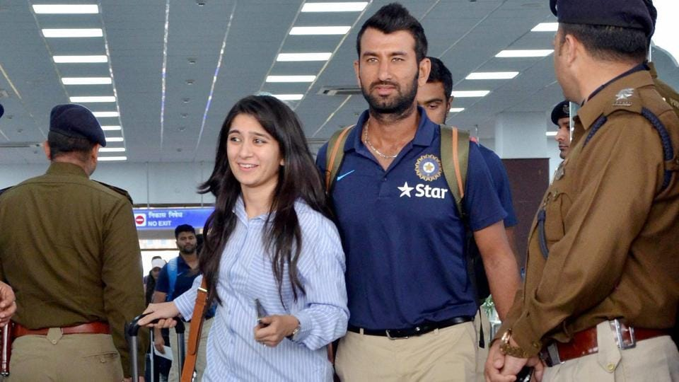 Cheteshwar Pujara arrives with his wife at Dharamsala airport ahead of the fourth and last Test match between India and Australia.