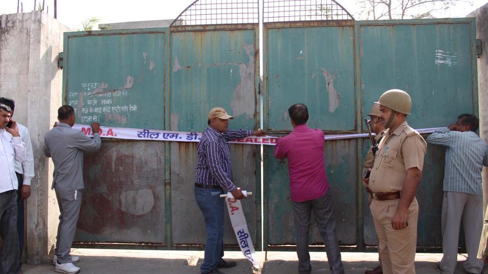 Officials seal slaughter houses near Alipur on Hapur road in Uttar Pradesh.