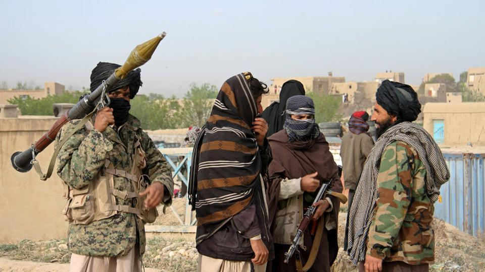 File photo of Taliban fighters at the site of the execution of three men accused of murdering a couple in Ghazni province, Afghanistan, in April 2015.