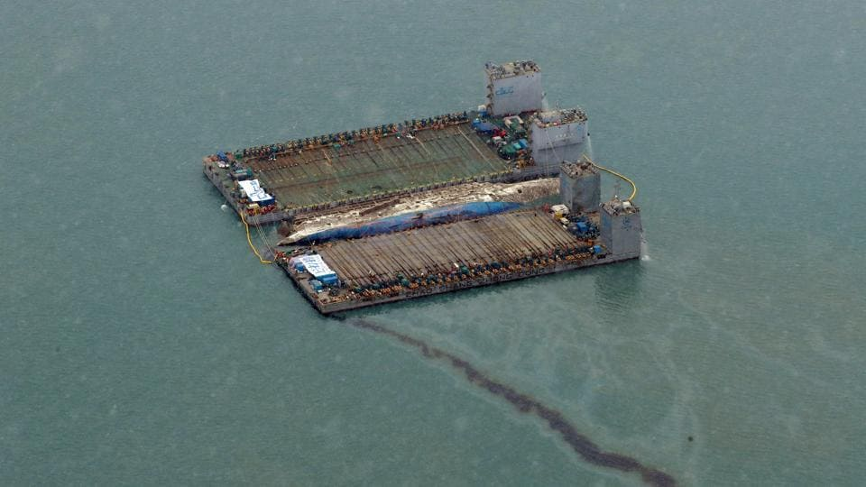 Leaked oil from the sunken ferry Sewol is seen during its salvage operations at the sea off Jindo, South Korea. South Korea's sunken Sewol ferry emerged from the waters Thursday, nearly three years after it went down with the loss of more than 300 lives and dealt a crushing blow to now-ousted president Park Geun-Hye. (REUTERS)