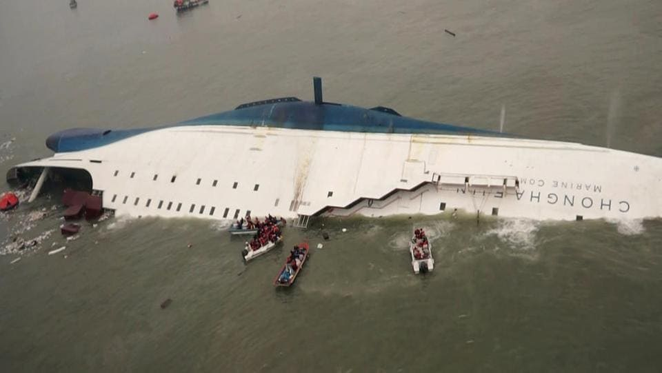 In this April 16, 2014, file photo released by South Korea Coast Guard, South Korean rescue boats and fishing boats approach the sinking South Korean ferry Sewol in the waters off Jindo, South Korea.  A permanent Sewol protest site targeting her was subsequently set up in the centre of Seoul, with effigies of the head of state on display alongside pictures of the dead schoolchildren. (South Korea Coast Guard/File Photo)