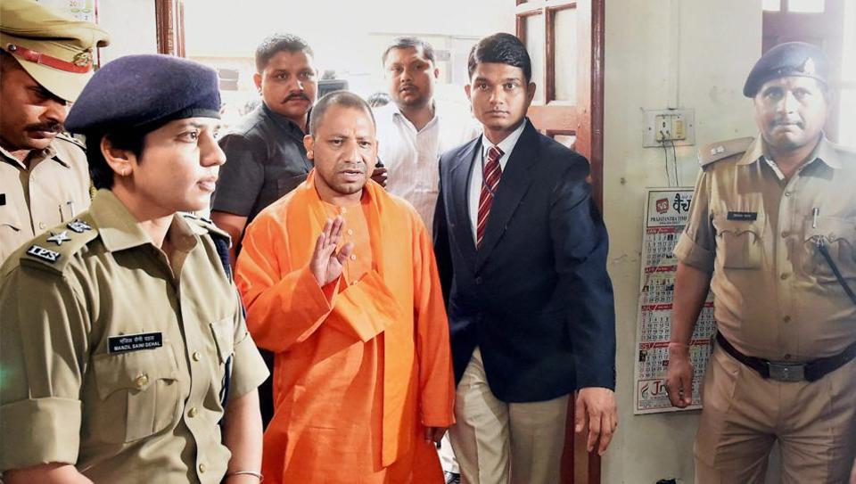 UP chief minister Yogi Adityanath during a surprise visit to the Hazratganj police station in Lucknow on Thursday. UP Police has suspended over 100 policemen since the new government assumed office.