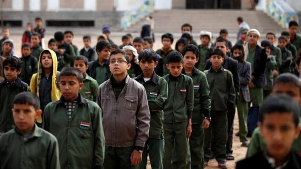 Boys take part in a morning drill at The al-Shawkani Foundation. (Khaled Abdullah / Reuters)