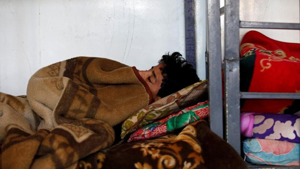 A boy sleeps at The al-Shawkani Foundation for Orphans Care in Sanaa. (Khaled Abdullah / Reuters)