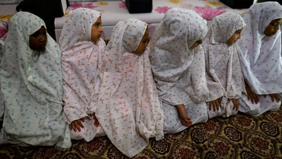 Girls perform dawn prayers at an orphanage in Sanaa. (REUTERS)