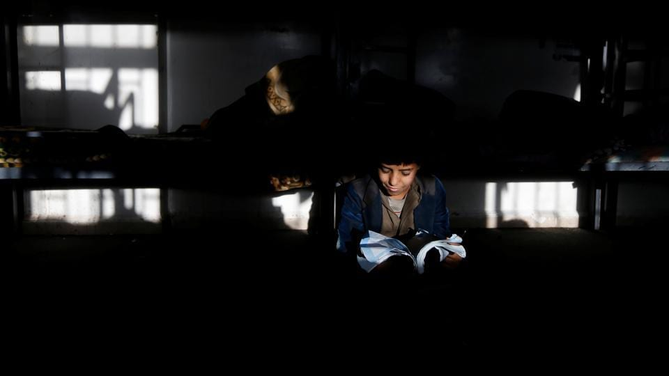 A boy studies in a dorm of The al-Shawkani Foundation. (Khaled Abdullah / Reuters)