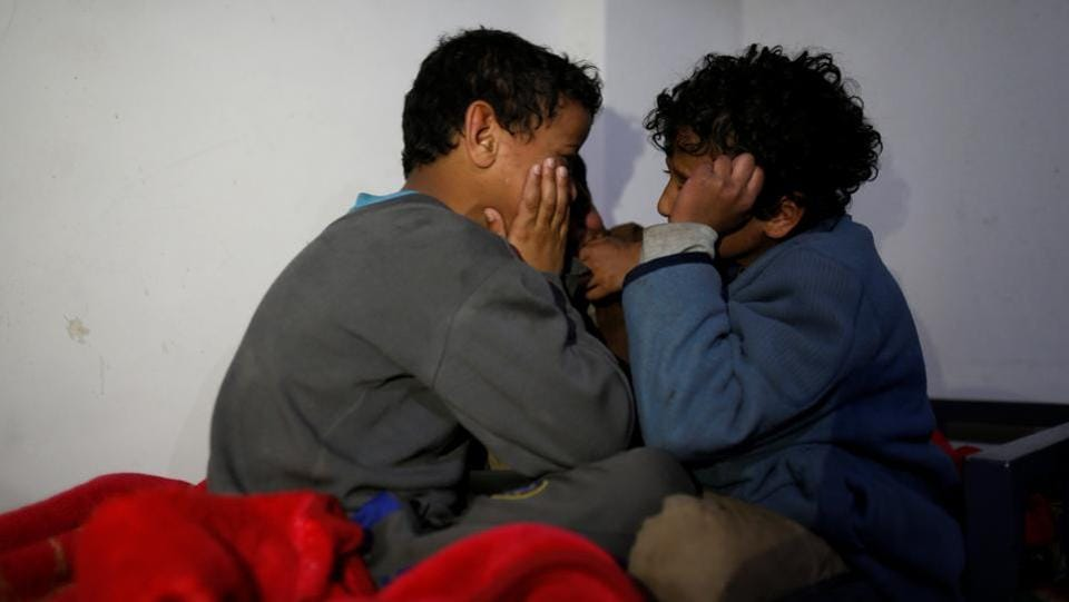 Boys chat before they go to bed at The al-Shawkani Foundation for Orphans Care . (Khaled Abdullah / Reuters)