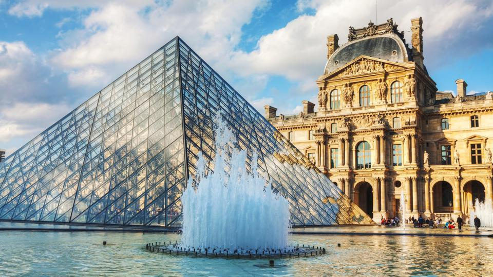The Louvre Pyramid in Paris, France serves as the main entrance to the Louvre Museum. Completed in 1989 it has become a landmark of Paris.