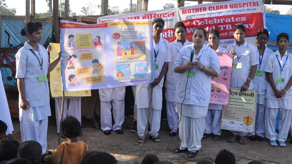 Staff members of Mother Clara Hospital conduct a programme to raise awareness on tuberculosis, in Bhopal.