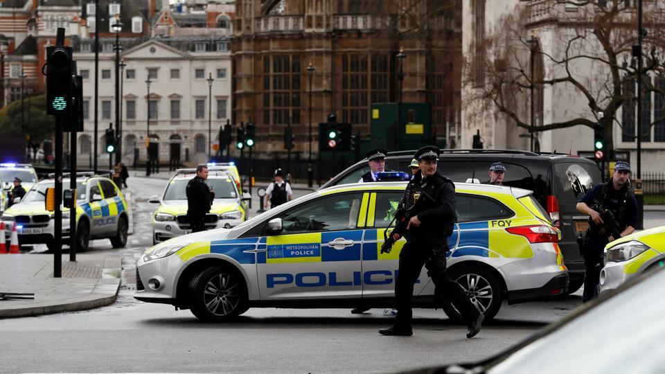 London police say they are treating a gun and knife incident at Britain's Parliament
