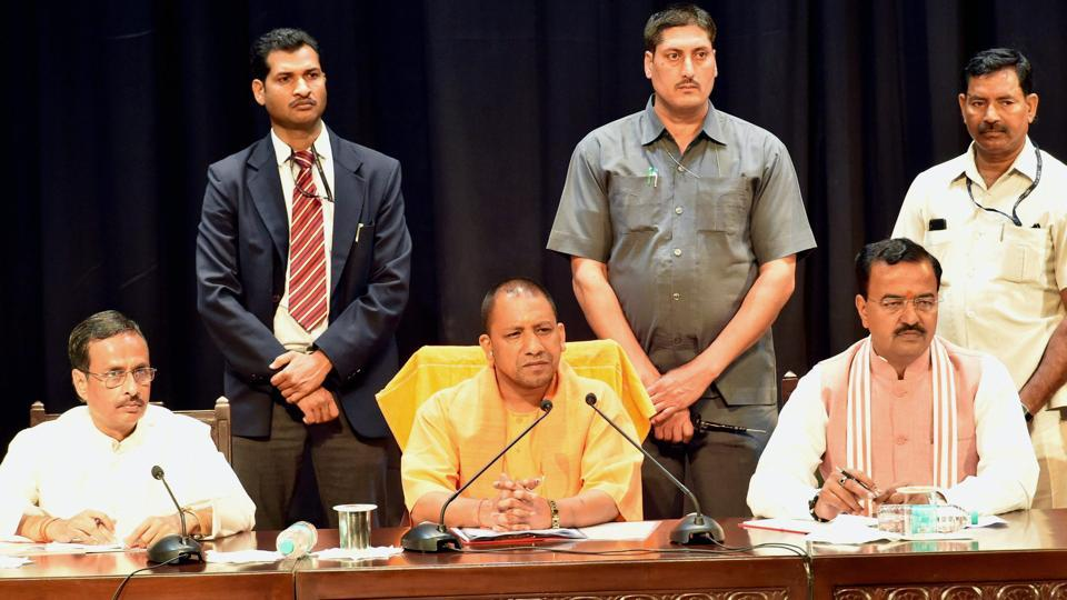 UP chief minister Yogi Adityanath with deputy CMs Dinesh Sharma and Keshav Prasad Maurya at a meeting of police officers at Lok Bhawan in Lucknow on Monday.