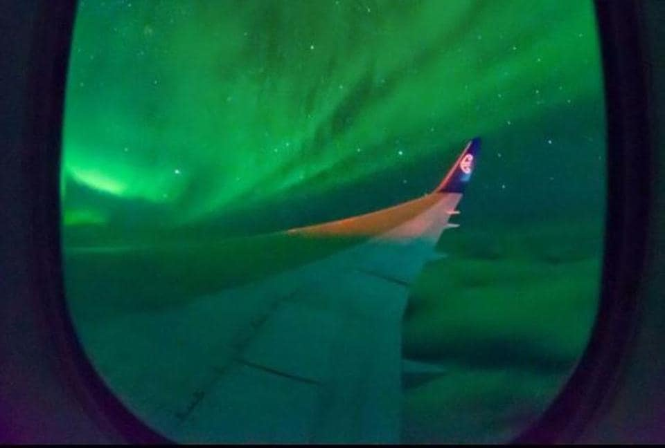 A view of the Southern Lights from the chartered Boeing 767.