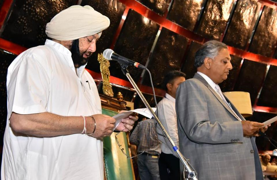Chief minister Capt Amarinder Singh being administered the oath as MLA by pro-tem speaker Rana KP Singh on the first day of the maiden session of the 14th assembly of Punjab on Friday, March 24. (Keshav Singh/HT)
