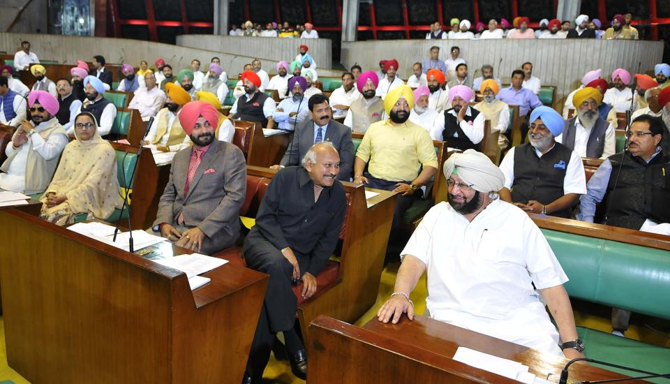 Congress ministers and other MLAs in the Punjab Vidhan Sabha on the first day of the maiden session of the 14th assembly on Friday, March 24. (Keshav Singh/HT)