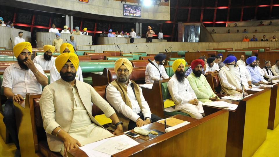 AAP MLAs in the Punjab Vidhan Sabha on the first day of the maiden session of the 14th assembly on Friday, March 24. (Keshav Singh/HT)