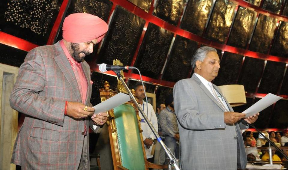 Local bodies and culture minister Navjot Singh Sidhu being administered the oath as MLA by pro-tem speaker Rana KP Singh on the first day of the maiden session of the 14th assembly of Punjab on Friday, March 24. (Keshav Singh/HT)