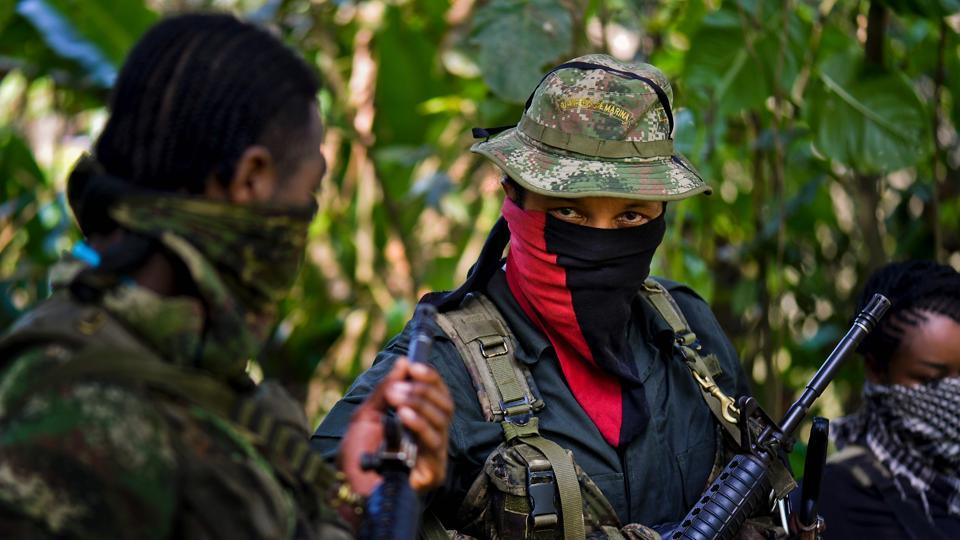 This photo taken on January 26, 2017 shows Danilo Hernandez, (C) commander of the Western Front of War Cimarron Resistance of the National Liberation Army (ELN), during an interview with AFP in Alto Baudo, in the department of Choco.