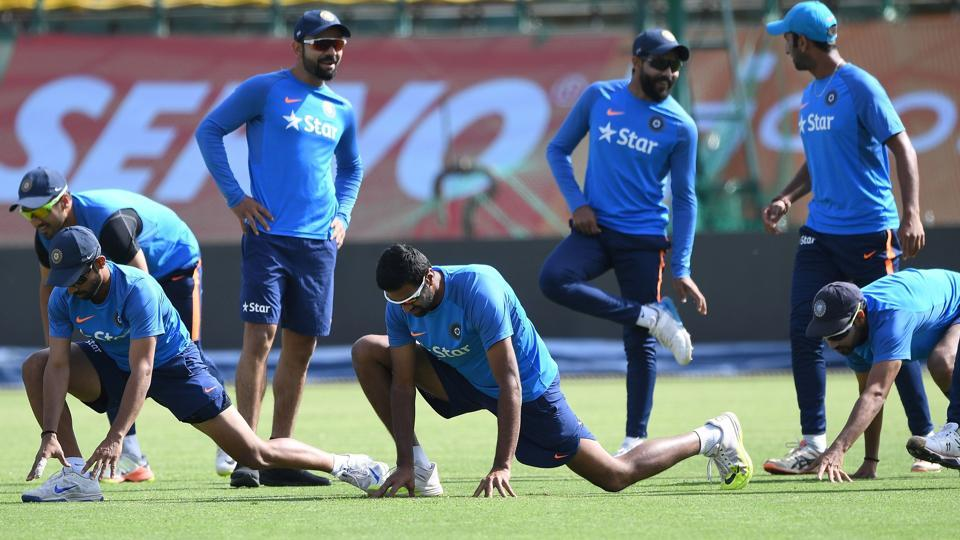 Virat Kohli (3rd L) warms up with teammates during the training session. (AFP)