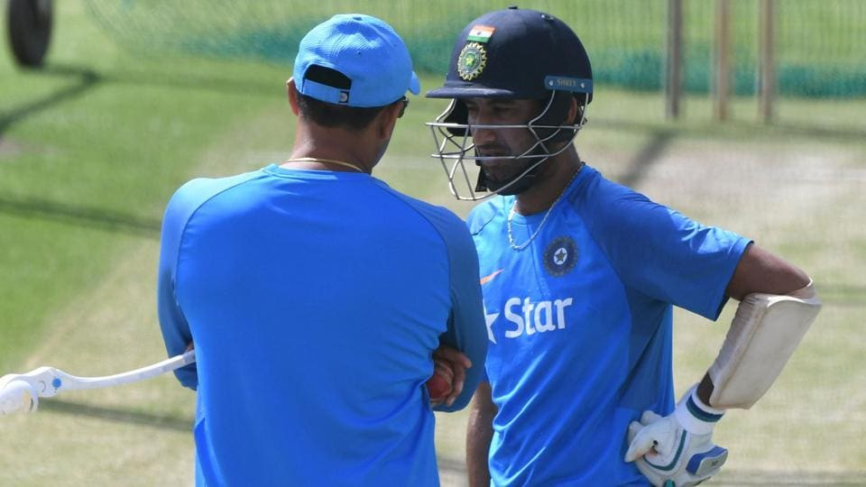 India coach Anil Kumble talks with batsman Cheteshwar Pujara (R) during a training session in Dharamsala. (AFP)