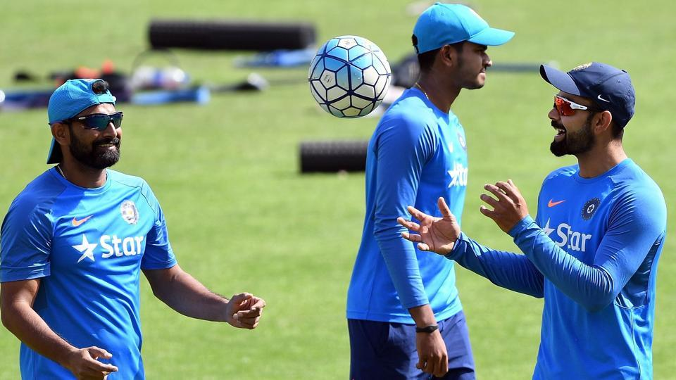 Virat Kohli (R) catches a ball during a training session on the eve of fourth Test against Australia. (AFP)