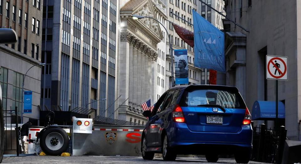 A car waits to enter the financial district security zone near the New York Stock Exchange (NYSE) in New York City, US.