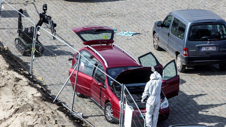 A forensics expert stands next to a car which had entered the main pedestrian shopping street in the city at high speed, in Antwerp, Belgium, March 23, 2017.