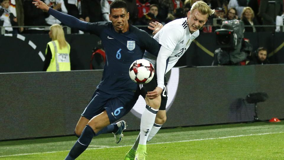 England's Chris Smalling will miss the World Cup qualifier against Lithuania at Wembley on Sunday, owing to injury.