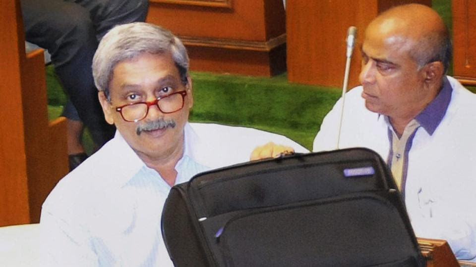 Goa chief minister Manohar Parrikar at the Goa Assembly with documents related to the state's Budget, in Panaji on Friday.