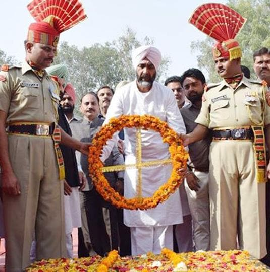 Punjab minister Manpreet Badal laying a wreath at the martyrs' memorial in Hussainiwala on Thursday.