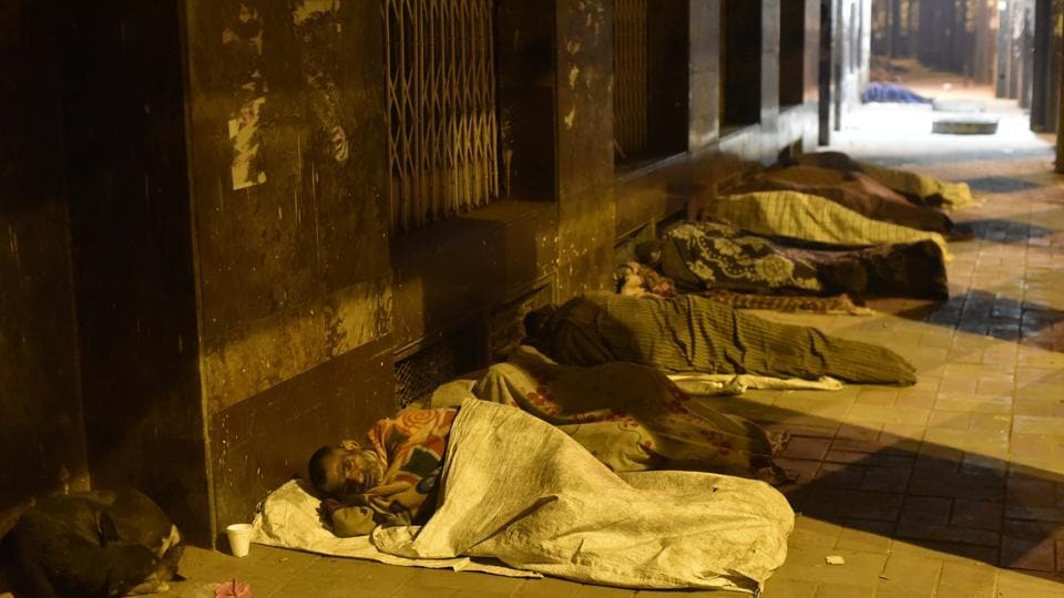 The homeless sleep on a pavement on a cold winter night at Asif Ali road in New Delhi.