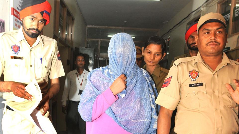 Police taking Seerat Kaur Dhillon for medical check­up at the civil hospital, Phase 6, SAS Nagar a few days back.