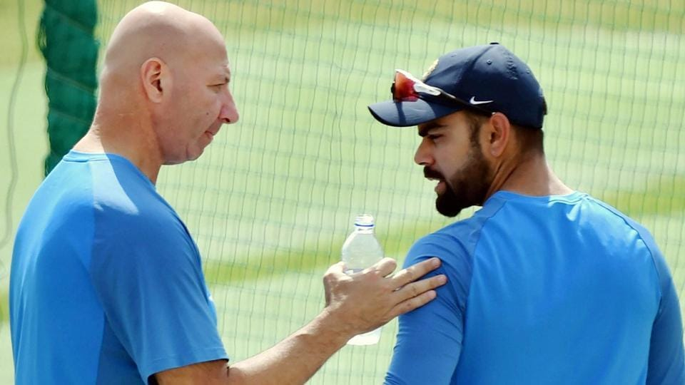 Indian cricket team captain Virat Kolhi with team's physiotherapist Patrick Farhart during the practice session in Dharamsala. (PTI)