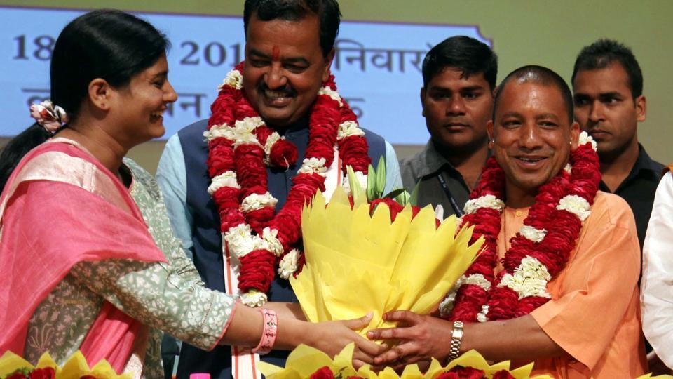 Uttar Pradesh chief minister Yogi Adityanath and his deputy Keshav Prasad Maurya during the swearing-in ceremony on Sunday.