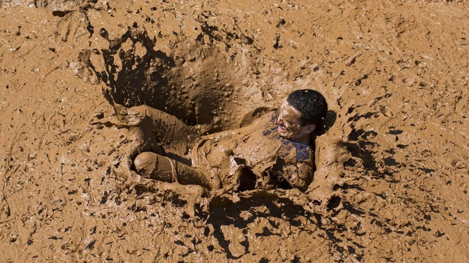 A Participant takes part in the Mud Day race, a 13 kilometer obstacle course in Tel Aviv, Israel. (Oded Balilty/AP)