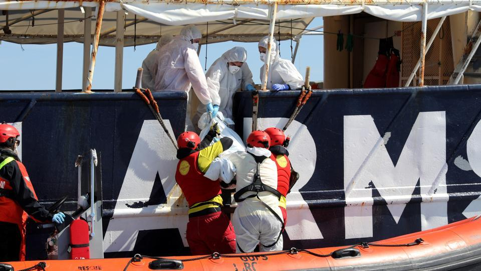Lifeguards from the Spanish NGO Proactiva Open Arms lift the body of a migrant onto the former fishing trawler Golfo Azzurro during a search and rescue operation in central Mediterranean Sea off the Libyan coast.